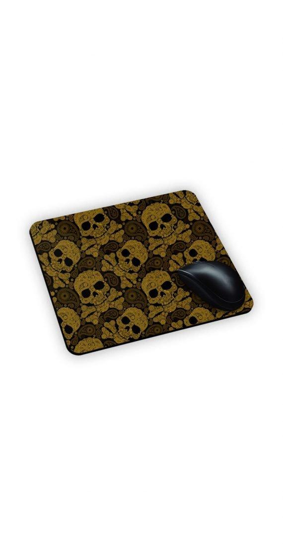 Teschi dorati su mouse pad